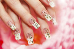 Floral French manicure. Floral French manicure on the pink white background stock images