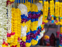 Floral Garlands in Kuala Lumpur, Malaysia. Floral garlands in yellow, white, blue, red and purple for sale at Batu Caves, Kuala Lumpur, Malaysia Stock Image