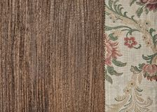 Floral green fabric on old wood background. Floral green fabric on the old wood background royalty free stock images