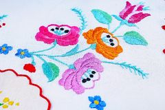 Floral handwork embroidery closeup photo. Hobby patchwork texture pattern closeup. Stock Image