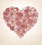 Floral Heart. Retro flowers in pinks and brown make up heart shape on textured background Royalty Free Stock Photo