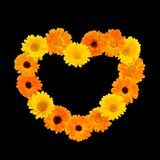 Floral heart isolated on black background. Floral heart isolated object on black background. Floral arrangement in outline shape heart of yellow and orange Royalty Free Stock Photo