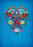 Floral heart. Mexican embroidery heart on blue linen Stock Photography
