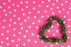 Floral heart on pink dotted background. Floral green heart on pink dotted background Stock Image
