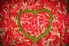 Floral heart shape. Beautiful red petal on the floor Stock Image