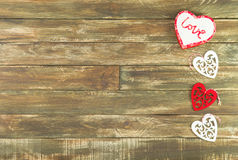 Floral Hearts Hanging over vintage Brown Wooden Background. Red and white Hearts Hanging over Brown Wooden Background. Romantic Decoration For Valentines Day stock image