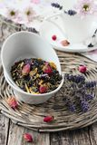 Floral herbal tea on a wooden table. Stock Photos