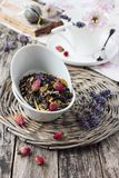 Floral herbal tea on a wooden table. Royalty Free Stock Photo