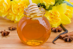 Floral jar of  honey Stock Image