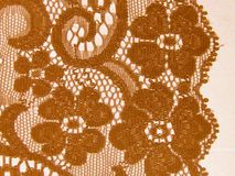 Floral lace band. Light brown or beige floral lace band ribbon stock photography