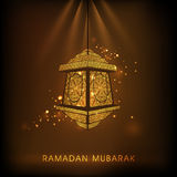 Floral lamp for Muslims holy month Ramadan Kareem celebration. Beautiful floral design decorated Arabic hanging lamp on shiny brown background for holy month of Stock Photo