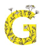 Yellow letter G with camomile flowers. Floral letter design with hand-drawn camomile flowers Royalty Free Stock Images