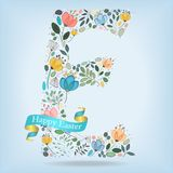 Floral Letter E with blue ribbon Royalty Free Stock Images