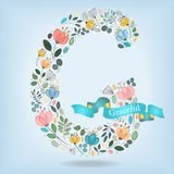 Floral Letter G with blue ribbon Stock Images