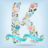 Floral Letter K with blue ribbon Stock Photos
