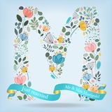 Floral Letter M with blue ribbon Royalty Free Stock Photos