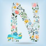 Floral Letter N with blue ribbon Royalty Free Stock Images