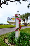 Floral Mailbox. Old outdoor mailbox decorated with strands of flowers and the word LOVE painted on box on coastal area of Florida Stock Photography