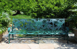 Floral metal Bench in park Stock Photography