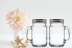Floral mock-up of 2 mason jars, with lids Stock Images