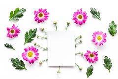Floral mockup. Sheet of paper in frame of pink flowers on white background top view. Floral mockup. Sheet of paper in floral frame on white background top view Stock Images