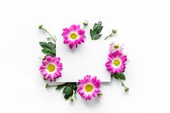 Floral mockup. Sheet of paper in frame of pink flowers on white background top view. Floral mockup. Sheet of paper in floral frame on white background top view Royalty Free Stock Images