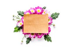 Floral mockup. Sheet of paper in frame of pink flowers on white background top view. Floral mockup. Sheet of paper in floral frame on white background top view Stock Image
