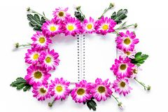Floral mockup. Sheet of paper in frame of pink flowers on white background top view. Floral mockup. Sheet of paper in floral frame on white background top view Royalty Free Stock Image