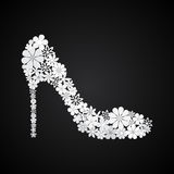 Floral mosaic white shoe on black background. White shoe on a high heel consisting of flowers Royalty Free Illustration