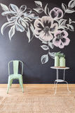 Floral motif on blackboard wall. Creative floral motif on blackboard wall in bright room royalty free stock images
