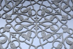 Floral motif carving pattern made from GRC at building exterior Stock Photo