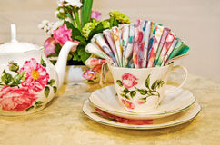 Floral napkin fan in tea cup Stock Images