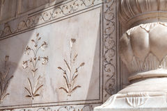 Floral ornament on the marble wall Royalty Free Stock Photos