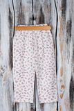 Floral pants on wooden hanger Royalty Free Stock Photo