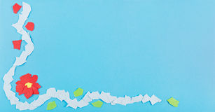 Floral paper scraps background. Blue paper background with a mosaic of torn floral paper scraps Stock Photo