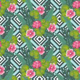 Floral paradise hand drawn tropic hibiscus flower with palm leaves on the geometric background. Seamless vector pattern. Stock Photos