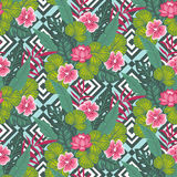Floral paradise, hand drawn tropic hibiscus flower with palm leaves on the geometric background. Seamless vector pattern. Stock Image