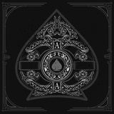 Floral pattern aroud circle shield with spades in the center inside ace of spades form. Vintage design playing card element. White on black royalty free illustration
