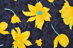 Floral pattern on blue fabric. Royalty Free Stock Photos