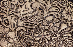 Floral pattern on brass plate Royalty Free Stock Images