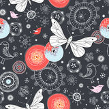 Floral pattern with butterflies and birds. Colored floral pattern with butterflies and birds on a dark background Stock Photography