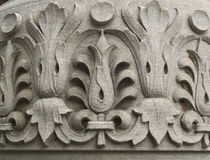Floral pattern carved into stone Stock Photos