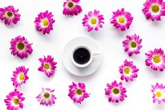 Floral pattern with cup of coffee on white background top view Royalty Free Stock Photography