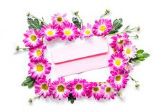 Floral pattern. Envelope in frame of pink flowers on white background top view Royalty Free Stock Photo