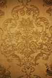 Floral pattern on  golden fabric Stock Photos