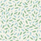 The floral pattern. Green leaves scattered on a beige background, seamless background, texture Stock Image