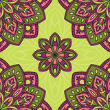 Floral pattern with mandalas. Vector seamless pattern with stylized floral mandalas. Gentle ornament on a green background. Oriental template for design Royalty Free Stock Image