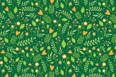 Floral pattern with orange flowers and red berries. Seamless floral pattern with orange flowers and green leaves on deep green background Stock Image