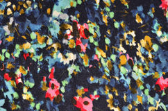 Floral pattern with painted spots on fabric. Royalty Free Stock Photography