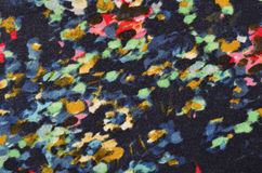 Floral pattern with painted spots on fabric. Stock Image